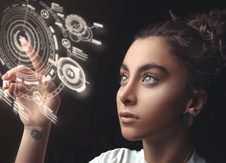 Female consumer exploring the benefits of new technology such as holographic displays
